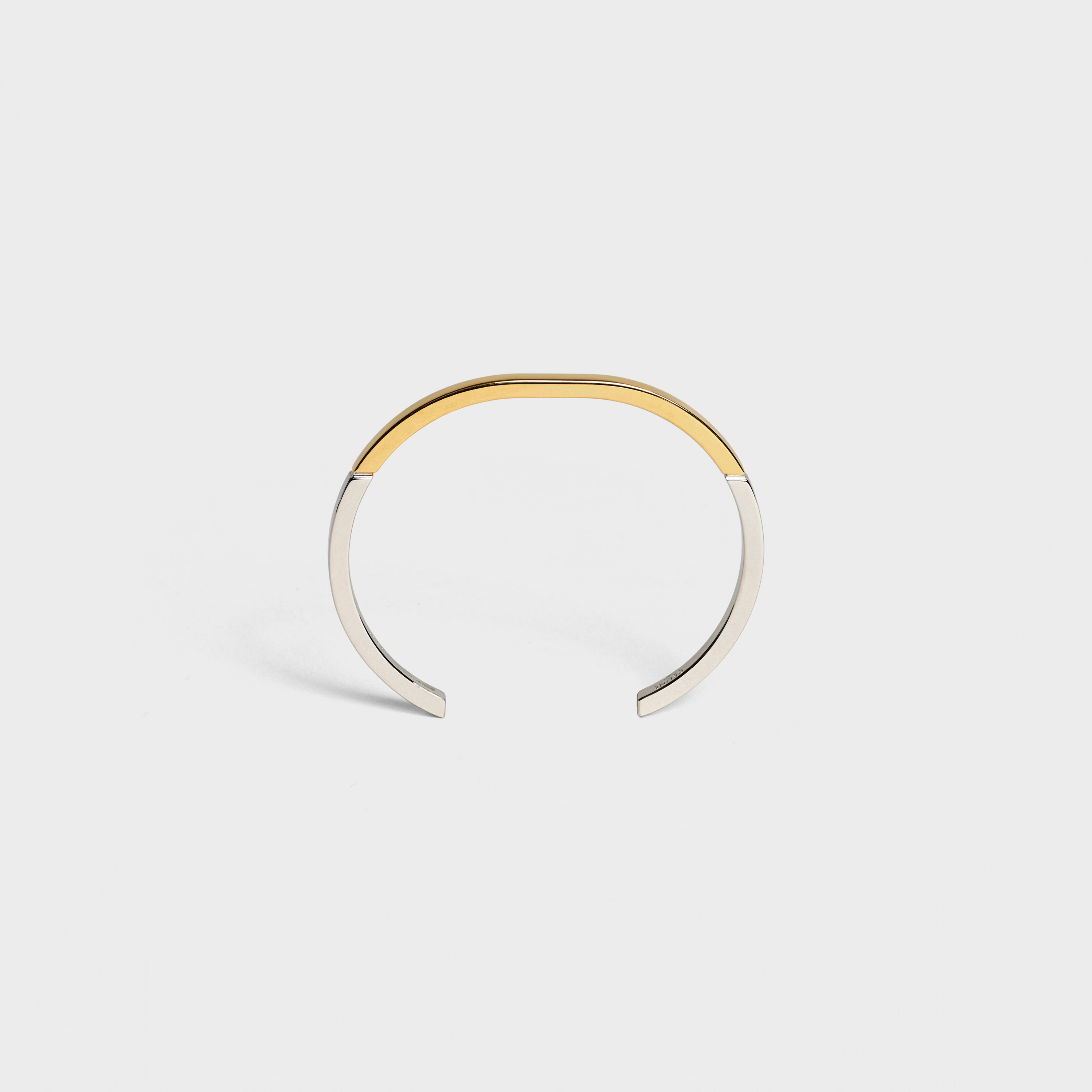 Simple Forms gold bracelet in brass with gold and rhodium finish | CELINE