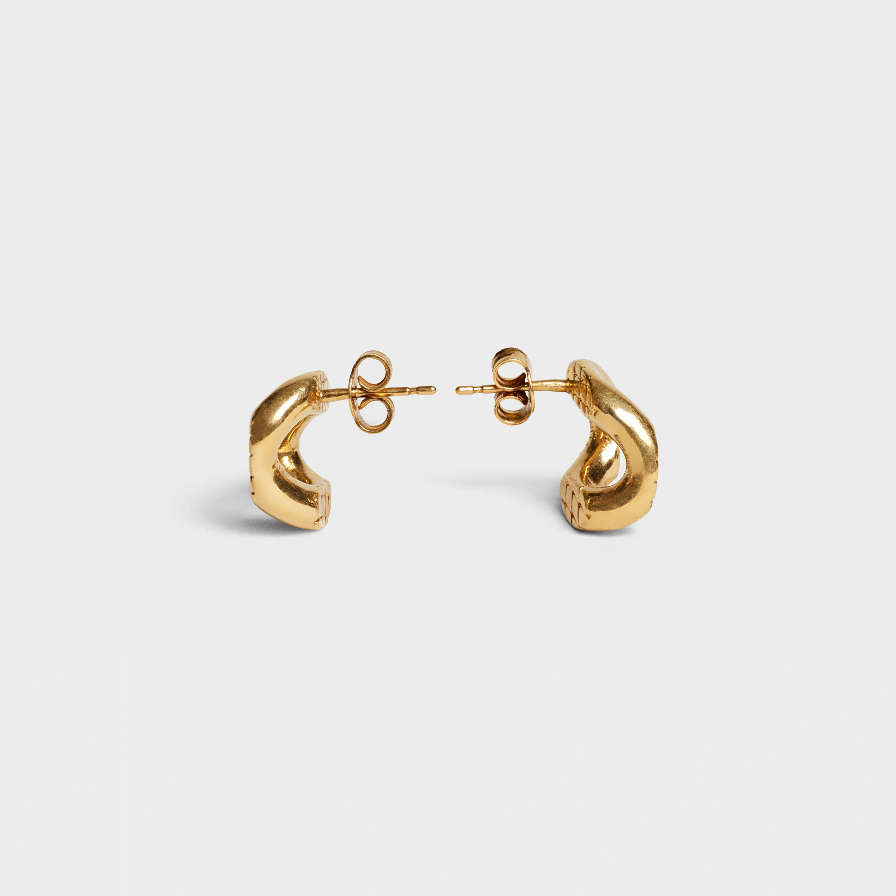 Celine Animals studs in brass with vintage gold finish | CELINE
